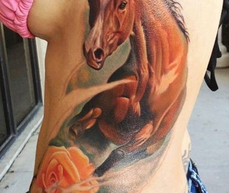 Watercolor  horse and rose tattoo on side
