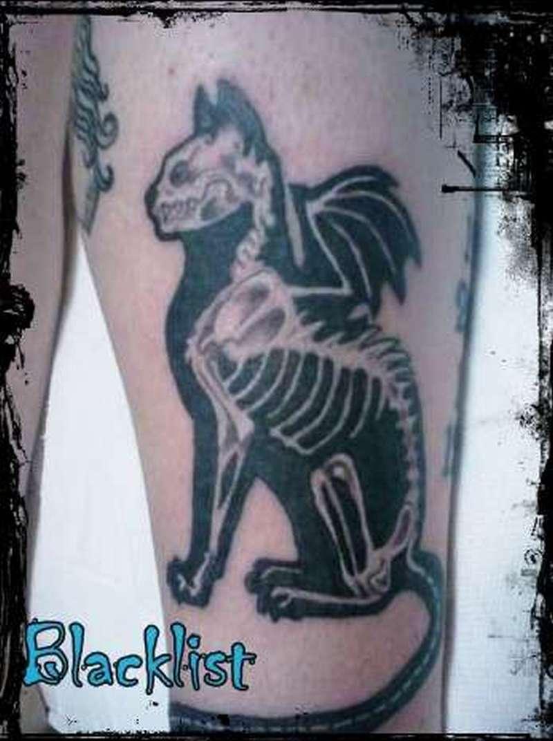 Winged demon cat tattoo