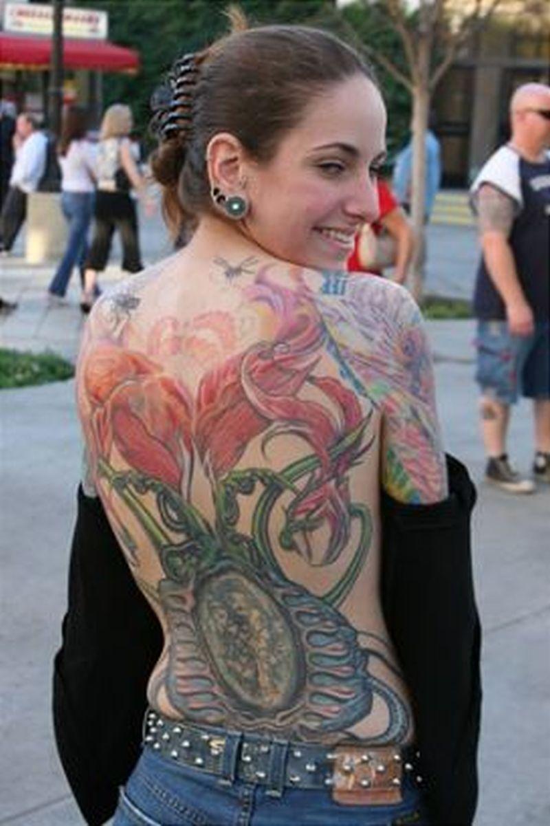Woman show off full body tattoo art