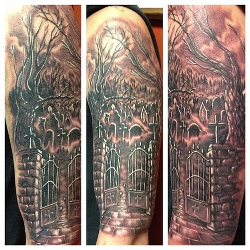 Wonderful graveyard tattoo design on the arm
