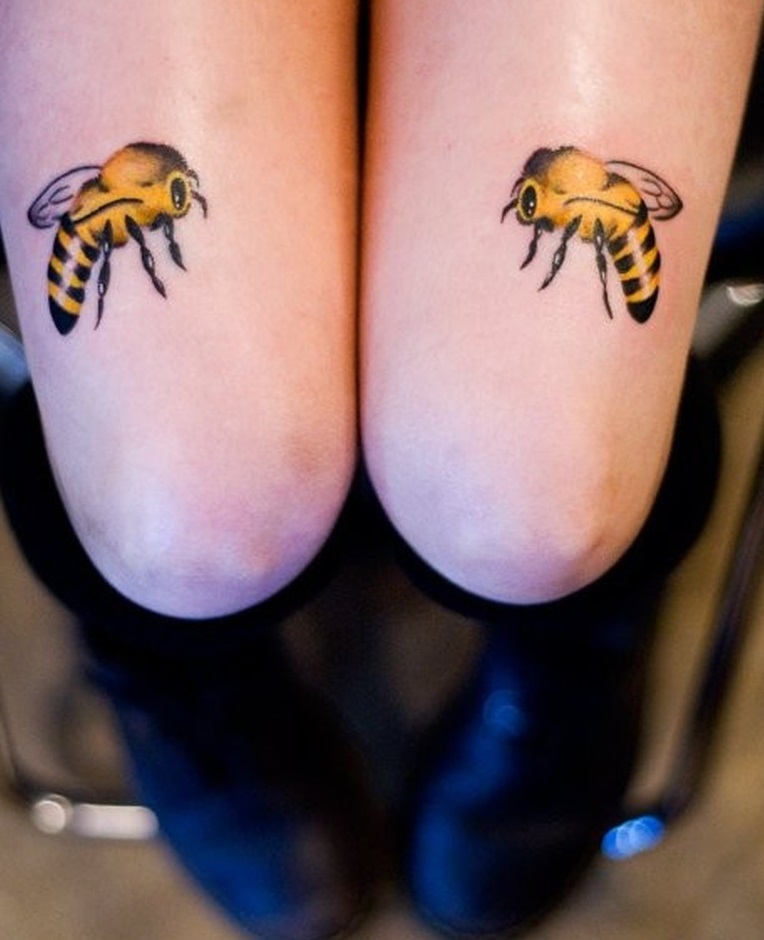 Yellow bee tattoo on knees