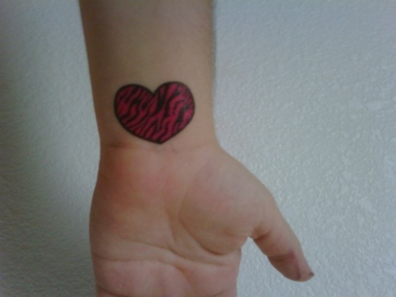 Zebra heart tattoo on wrist